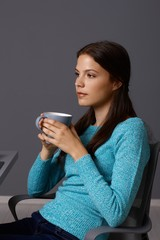 Young woman drinking tea thinking