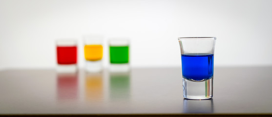 Shot Glasses With Colored Drinks