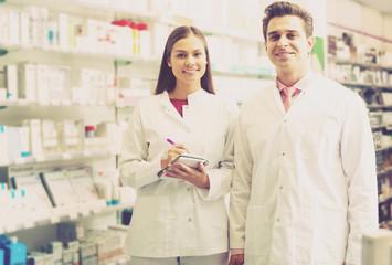 Portrait of two friendly pharmacists working