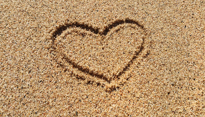 Abstract heart drawing in sand