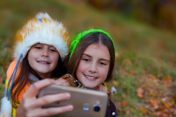 Two cute little sisters taking a photo of themself