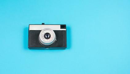 vintage film camera on blue background