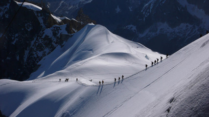 mountain climbers descending to the Mer de Glace from the Aiguille du Midi in the French Alps near Chamonix
