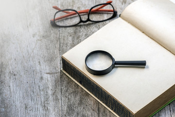 magnifier on blank notebook