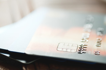 Credit cards on brown wallet in shallow focus