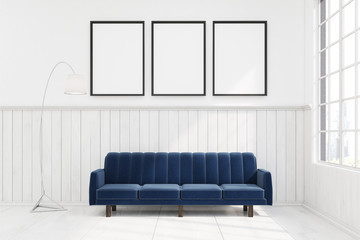 Dark blue sofa in a room with three posters