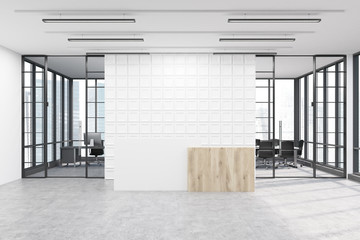 Office lobby with tiled white wall