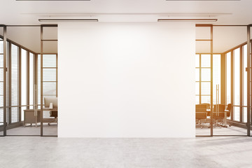 Office lobby with a large white wall and two meeting rooms, tone