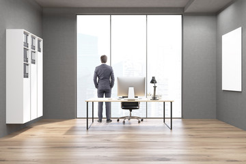 Rear view of a businessman in a CEO office