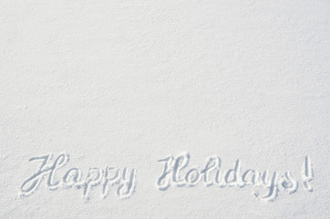 Beautiful Happy Holidays letters calligraphy handdrawn on flat snow surface. Nice Christmas holiday square postcard, greeting card template. Empty space for copy, text, lettering.