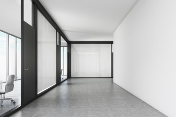 Empty office corridor with a meeting room
