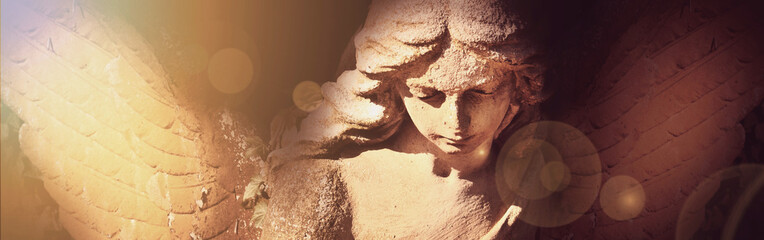 golden angel in the sunlight (antique statue) Wall mural