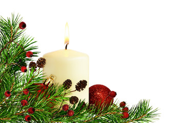 Christmas corner decoration with pine twigs, candle and balls