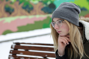 Pensive teen on bench
