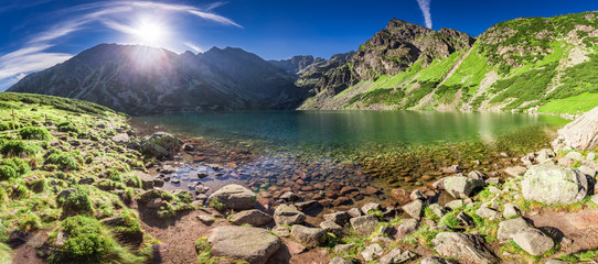 Panorama of sunrise at Czarny Staw Gasienicowy in Polish Mountains