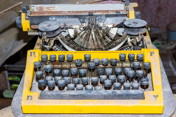 Retro broken typewriter in abandoned place
