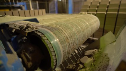 Wall Mural - View of defective brick on conveyor belt, close-up