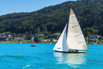 Vintage wooden sailboat on lake, sailing on Worthersee, Carinthi