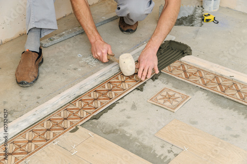 Worker Putting Tiles On The Floor Stock Photo And Royalty Free