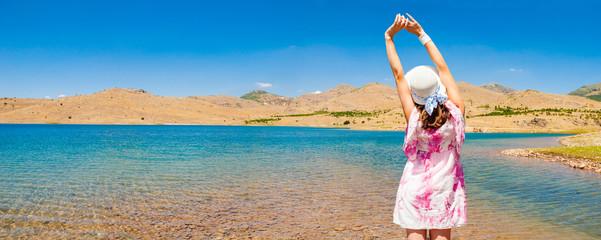Woman near the lake in desert