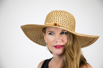 Mature Blonde Female In Large Hat Eyes Looking Away From Camera