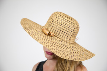 Blonde Female In Large Hat