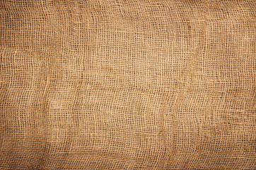 Linen or jute fabric background with visible texture. Horizontal photo taken from above, top view with copy space for packaging, text and other web or print design elements.