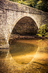 Tranquil scene of an arched stone bridge