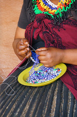 African woman making souvenirs for sell at Lesedi Cultural Villa