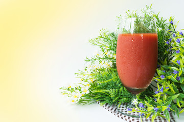 a glass of cold tomato juice to refresh your body, full of vitamin C, ready to serve, for background healthy drinks.
