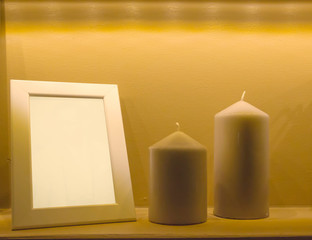 Frame white candles next to a vintage style.