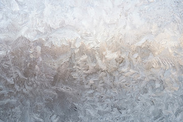 Winter patterns on glass from ice