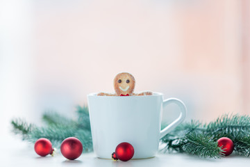 Gingerbread man with cup and christmas