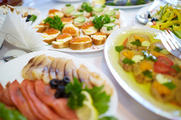 delicious appetizers with fish and lemon