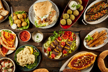 Various Mediterranean dishes and bread on table