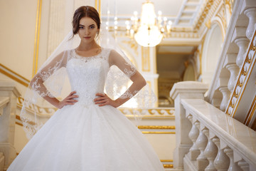 beautiful young woman bride in luxury wedding dress in interior