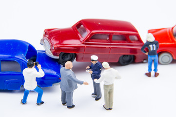 Miniature tiny toys car crash accident damaged.Accident on the r