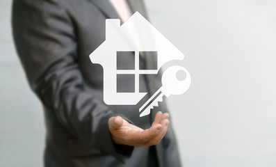 Businessman offers his hand in icon house with keyhole. Business woman present buy construction concept success. Sale home. Business arhitecture sign button solution insurance realtor. Real estate.