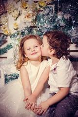 Little boy kissing a girl