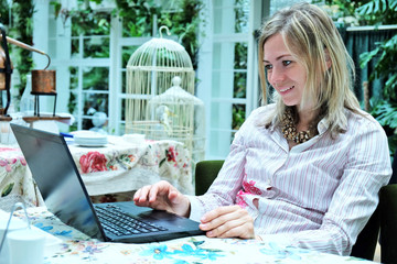 Beautiful blond woman with a laptop computer at home
