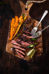 Grilled beef meat and roasted vegetables.