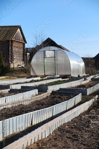 Handmade polycarbonate greenhouse and garden beds in the