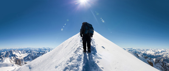 climbers approach the mountain top