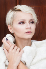 beautiful blonde woman wrapped in a blanket