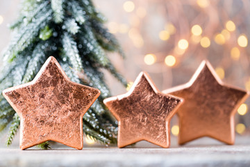 Christmas bronze decoration. Holiday decorations bronze on bokeh