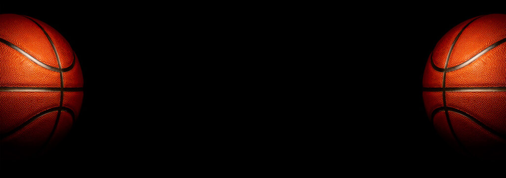Basketball on a black background. panoramic background or basketball with blank space