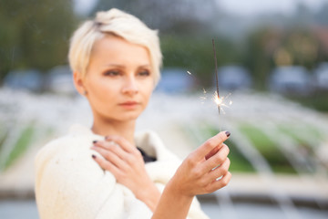 beautiful woman holding sparklers