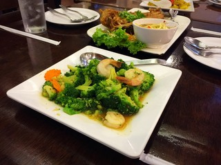 Stir-fired broccoli with shrimp on white dish