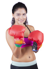 Young Indian woman with boxing gloves