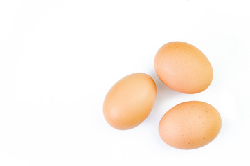 Three eggs are isolated on a white background